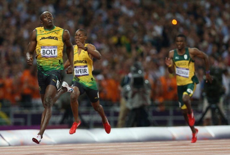 Za plecami Bolta na metę wpadło dwóch jego kolegów z reprezentacji (fot.Getty Images)